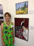 Dij Pacarro with two of her artworks